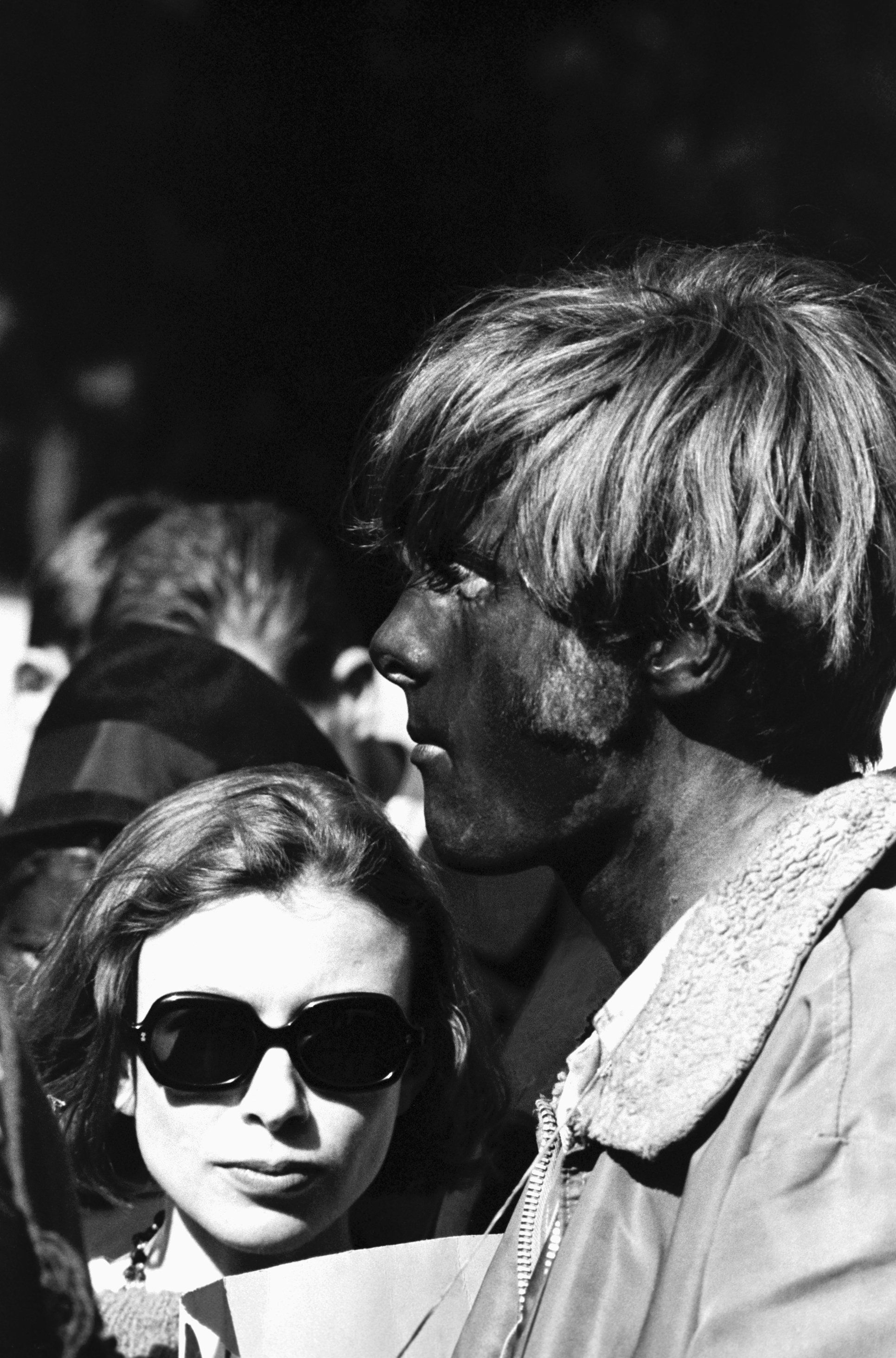 Author Joan Didion stands next to a face-painted hippie at a concert in Golden Gate Park. (Photo by © Ted Streshinsky/CORBIS/Corbis via Getty Images)