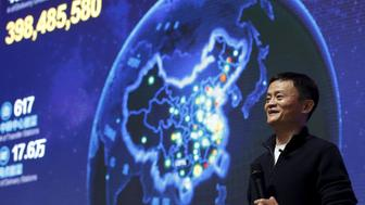 Alibaba founder and chairman Jack Ma gestures in front of a screen showing real-time data of transactions at Alibaba Group's 11.11 Global shopping festival in Beijing, China, November 11, 2015. Chinese e-commerce giant Alibaba Group Holdings Ltd said on Wednesday the value of merchandise it has sold so far during the Singles' Day online shopping extravaganza had surpassed last year's total of $9.3 billion. REUTERS/Kim Kyung-Hoon