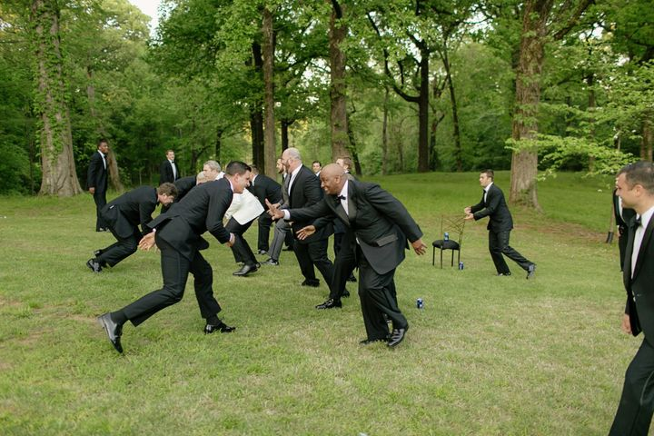 The groomsmen played a little game of touch football in their tuxes.