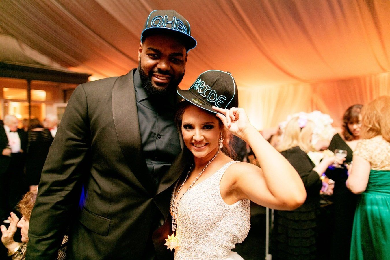 Michael Oher, the bride's adopted brother, currently plays for the Carolina Panthers.