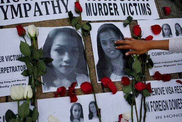 Tributes are left for Sumarti Ningsih, left, and Seneng Mujiasih,