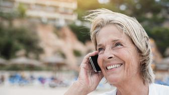 Spain, Senior woman talking on mobile phone