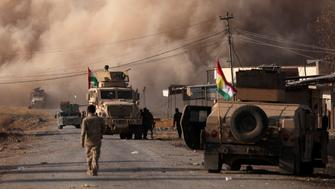 Smoke rises during clashes between Peshmerga forces and Islamic State militants in the town of Bashiqa, east of Mosul, during an operation to attack Islamic State militants in Mosul, Iraq, November 7, 2016. REUTERS/Azad Lashkari