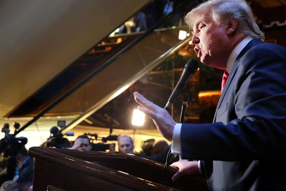 Donald Trump speaks about his book <i>Crippled America</i> in&nbsp;the Trump Tower atrium in New York in 2015.