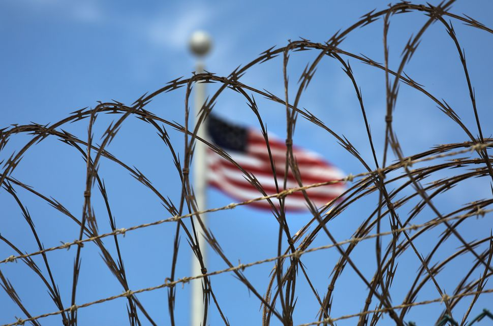 Razor wire tops the fence of the U.S. prison at Guantanamo Bay on Oct 23.