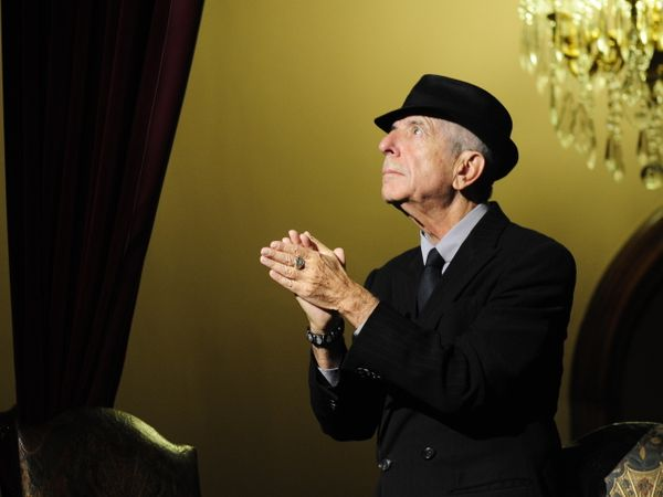 "Canadian singer Leonard Cohen acknowledges applauses before the concert ""A Tribute to Leonard Cohen"" at the Jovellanos Theatr"