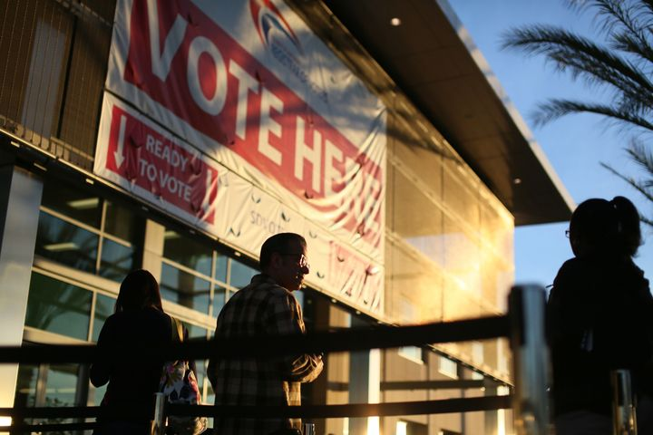 People in San Diego, California, wait to vote in the U.S. presidential election on Nov. 8, 2016.