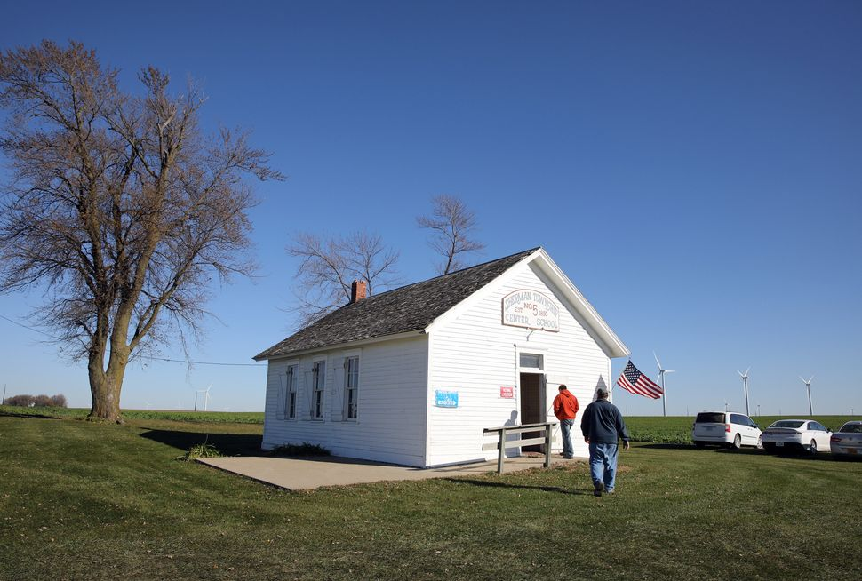 Voters head to the polls for the U.S. presidential election in a one-room schoolhouse near Colo, Iowa, U.S., Nov. 8.
