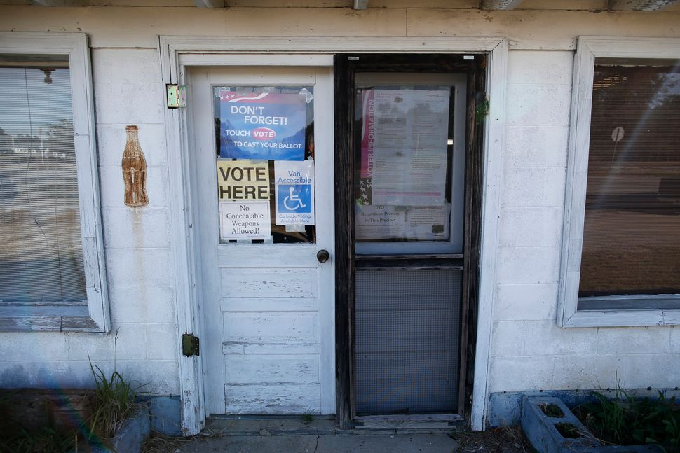Signs mark the entrance to voters for the Manning precinct polling station at the old Wilkerson Store during the U.S. preside