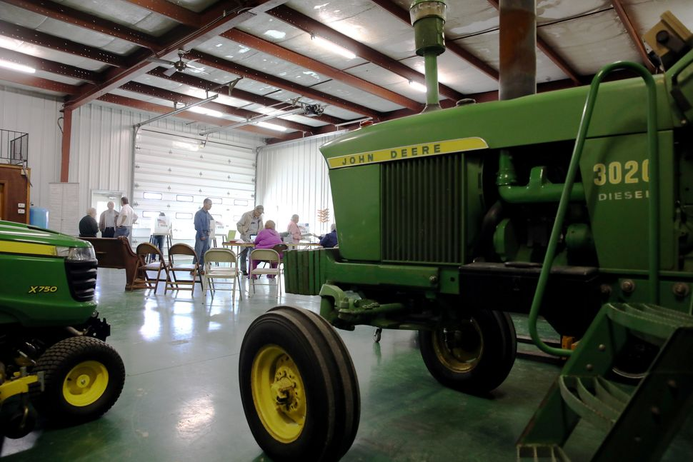 Voters cast ballots during the U.S. presidential election in a farm shed near Nevada, Iowa, on Nov. 8.