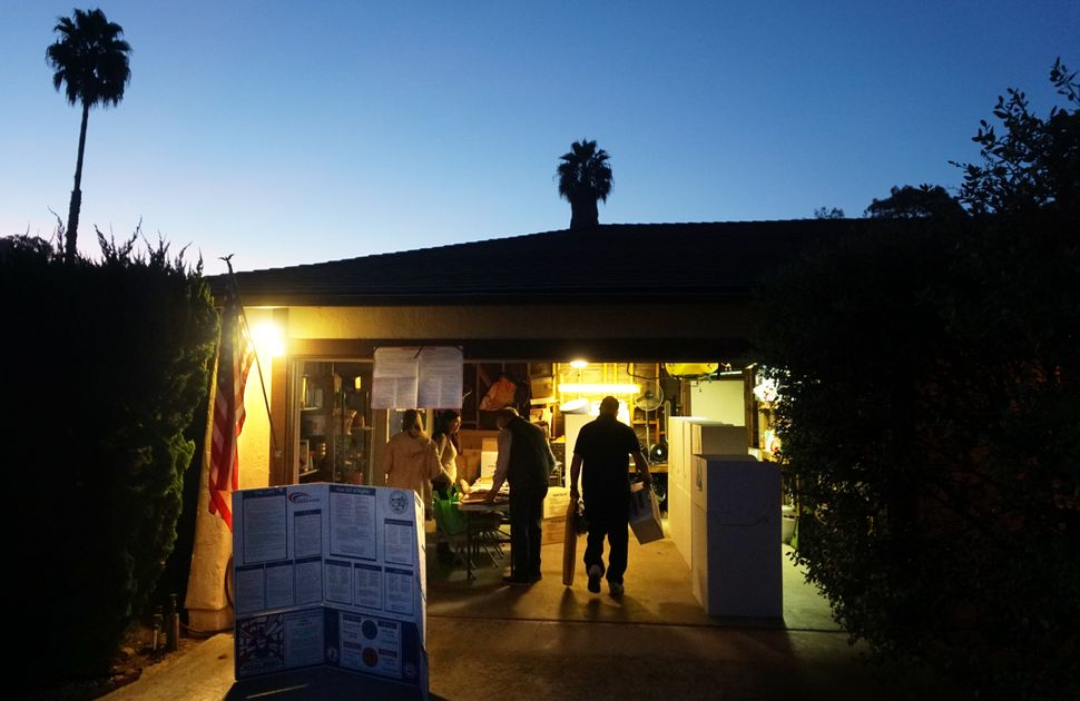 Poll volunteers set up booths at a home during voting in the 2016 presidential election in San Diego, California, on Nov. 8.