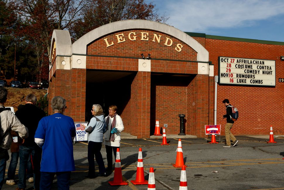 A voter enters the Legends theater polling place in Boone, North Carolina, on Nov. 8.