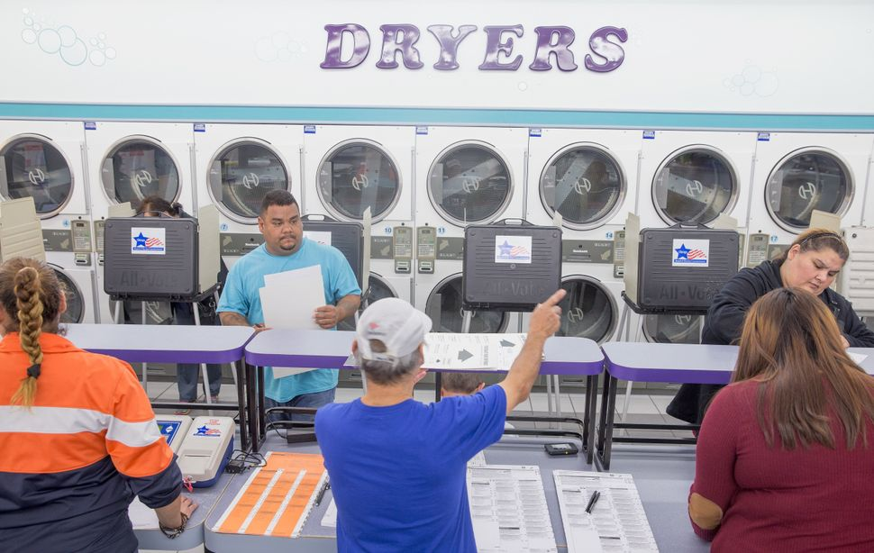 Voters cast ballots at Su Nueva Lavaderia Laundromat in the 2016 presidential elections in Chicago, Illinois, on Nov. 8.