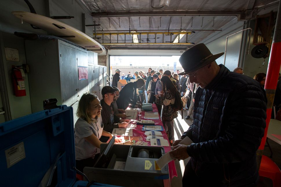 People vote at the Los Angeles Lifeguard station at Venice Beach in Los Angeles, California, on Nov. 8.