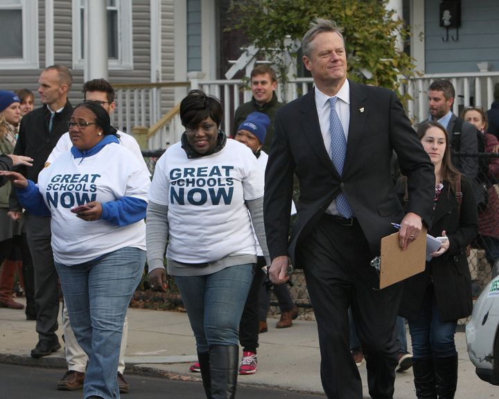 The Republican governor was seen going door to doorto help persuadevoters to lift the cap on the number of charte