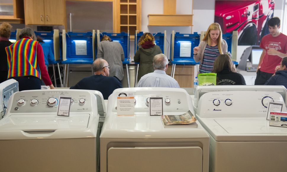 Voters cast their ballots in a polling location inside Mike's TV and Appliance in State College, Pennsylvania, on Nov. 8.