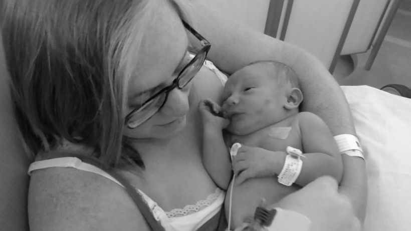 Ariane visiting her newborn baby boy in the NICU.