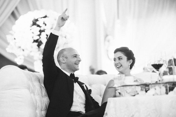 """The bride and groom&nbsp;were more than """"<a href=""""https://www.youtube.com/watch?v=f0EqxnWxlvY"""" target=""""_blank"""">Satisfied""""</a>&nbsp;with the surprise."""