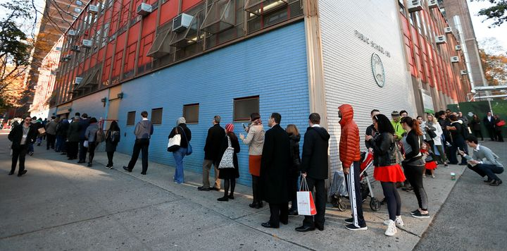 Lines of voters wrap around the outside of PS198M The Straus School as they wait to cast their ballots on November 8, 2016 in