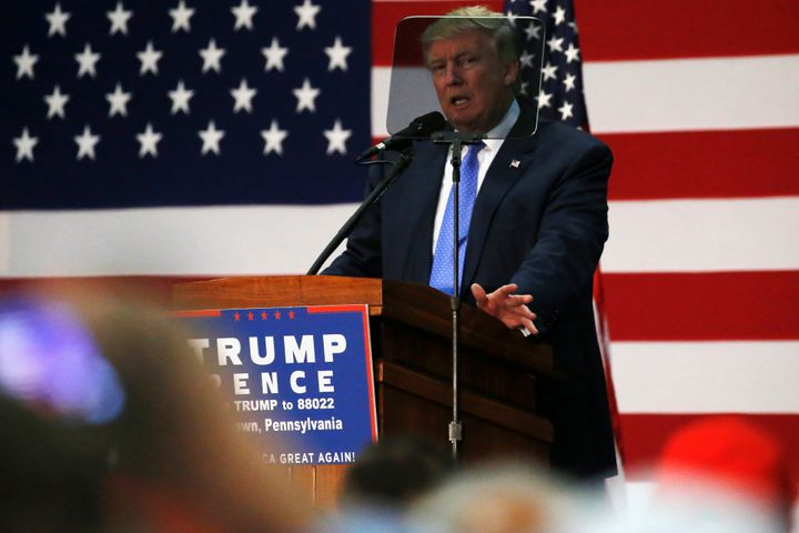 Republican presidential nominee Donald Trump reads from a teleprompter as he addresses a campaign rally in Newtown, Pa., on&n