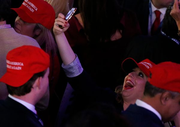 A Trump supporter takes a selfie as she celebrates with others as they watch election returns come in at Republican U.S. pres