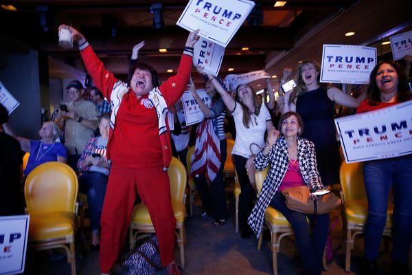 Republicans erupt in celebration as a newscaster announces Donald Trump wins Florida while watching election night results at