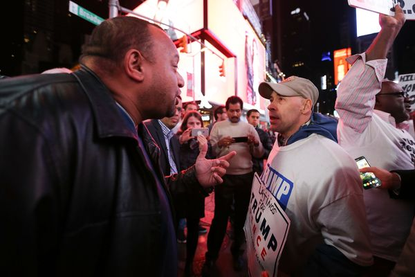 Donald Trump supporters and protestors argue in Times Square as they await election results  in New York, on Nov. 8