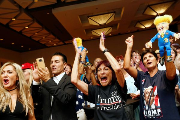 Donald Trump supporters cheer as U.S. presidential election results are announced during a Republican watch party in Phoenix,