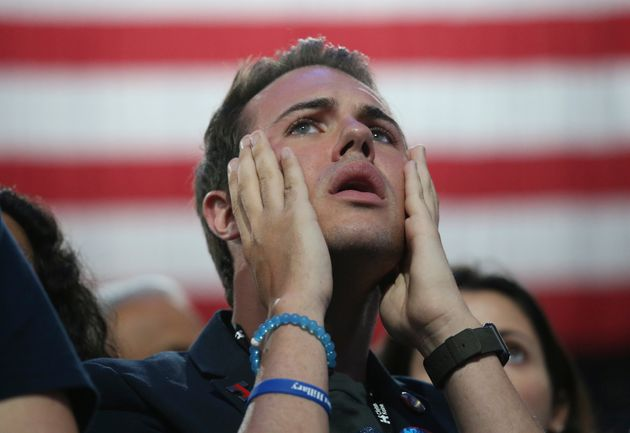 A supporter of Democratic U.S. presidential nominee Hillary Clinton reacts at the election night rally...