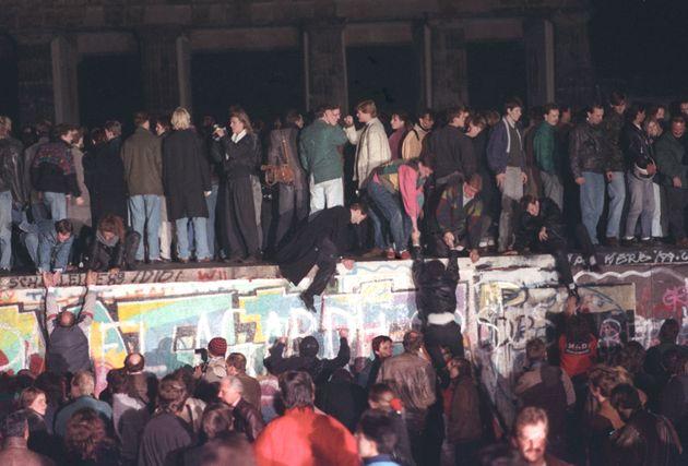 West Berlin citizens continue their vigil atop the Berlin