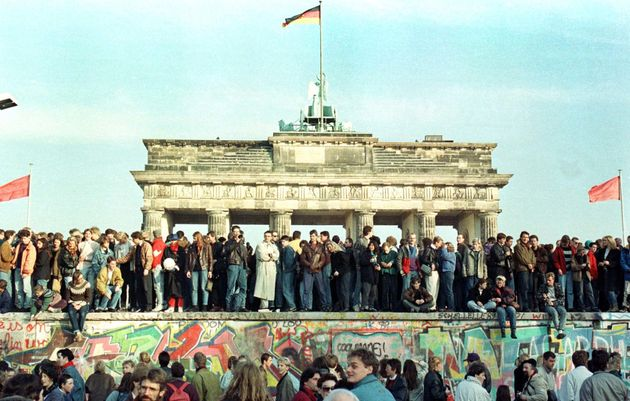 West Berlin citizens continue their vigil on top ofthe Berlin Wall in November