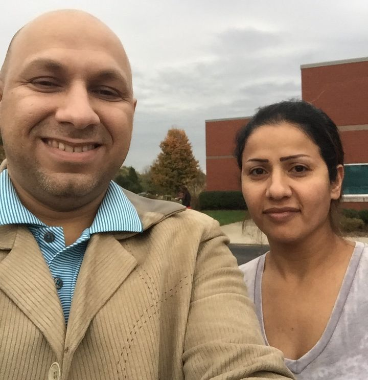 Asaad Alabdulaziz, who risked his life in Iraq to help American development workers, voted with his wife, Nada, for the first