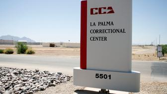 Signage stands outside the La Palma Correctional Center in Eloy, Arizona, U.S., on Tuesday, May 11, 2010. La Palma, which houses about 2,900 convicts from California, is one of 65 facilities operated by Corrections Corp. of America, the largest private-prison operator in the U.S. Photographer: Joshua Lott/Bloomberg via Getty Images