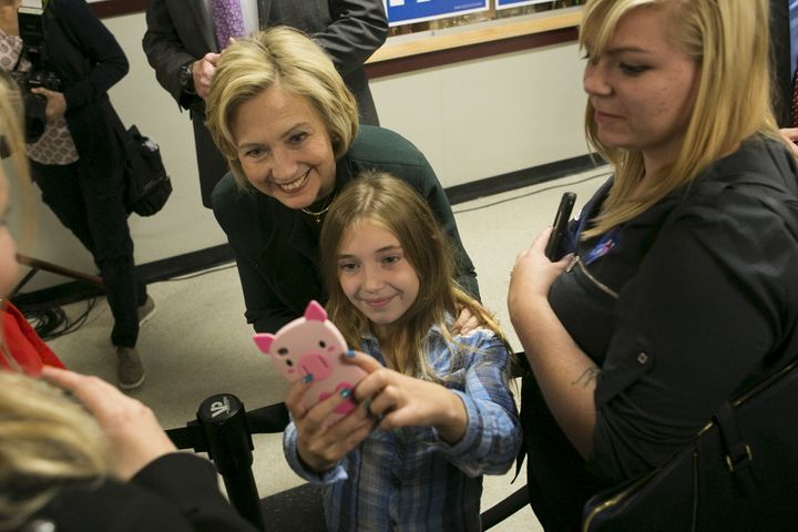 Former Secretary of State Hillary Clinton takes a selfie with 9 years old Katie Williamson of Franconia, New Hampshire at the