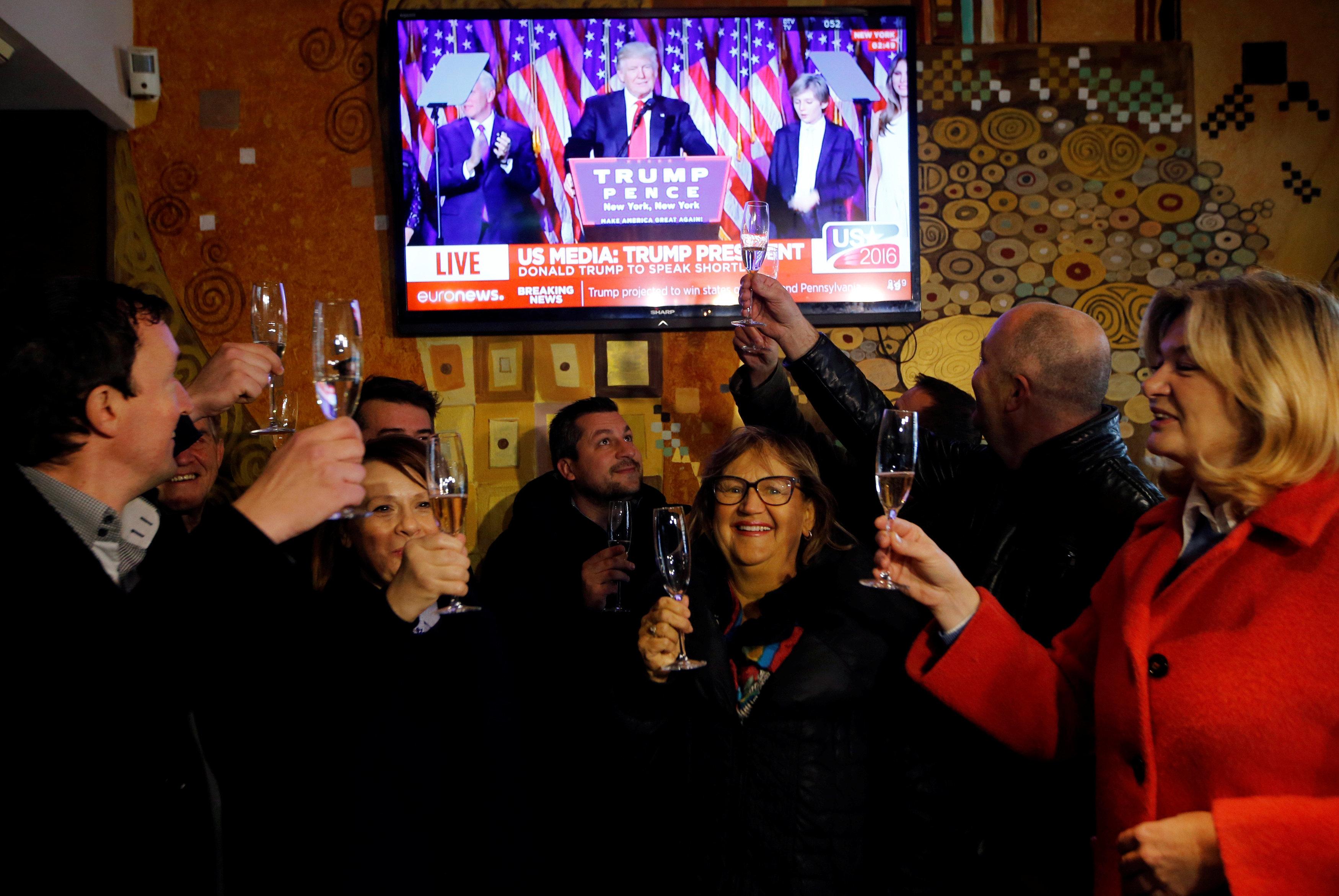 Residents celebrate during the U.S. presidential election in Melania Trump's hometown of Sevnica, Slovenia November 9, 2016. REUTERS/Srdjan Zivulovic