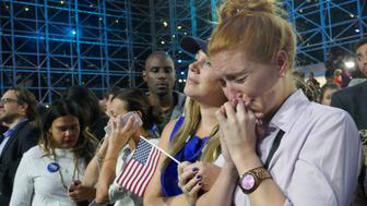 NEW YORK, UNITED STATES - NOVEMBER 09: Democratic Party's presidential nominee Hillary Clinton's supporters show their sorrow as the results indicate the Republican Party's presidential nominee Donald Trump's victory for the 2016 Presidential Elections at Jacob K. Javits Convention Center in New York, NY, USA on November 9, 2016. Republican nominee Donald Trump won victory against Democratic challenger Hillary Clinton on US presidential election. (Photo by Selcuk Acar/Anadolu Agency/Getty Images)