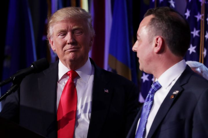 Republican president-elect Donald Trump and Reince Priebus, chairman of the Republican National Committee, look on during his election night event at the New York Hilton Midtown in the early morning hours of November 9, 2016 in New York City.