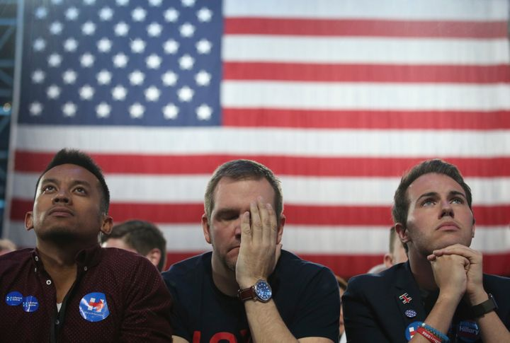 Supporters of Democratic U.S. presidential nominee Hillary Clinton react as they watch results at the election night rally in