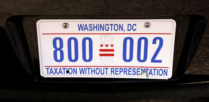 "The district's license plates read, ""Taxation without representation."" This one was on a motorcade vehicle of President Barac"