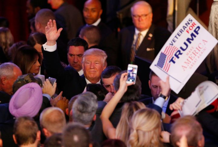 Donald Trump gestures to the crowd after addressing his supporters and celebrating his presidential win on Nov. 9, 2016.