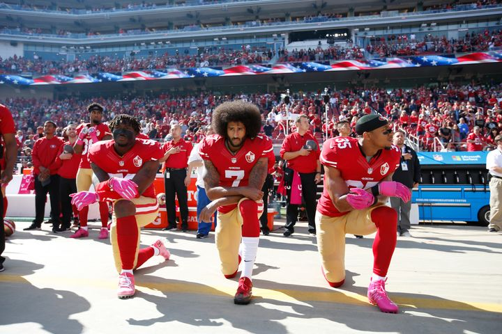 Support grew for quarterback Colin Kaepernick's protests. Eli Harold, left, and Eric Reid, right, of the San Francisco 49ers