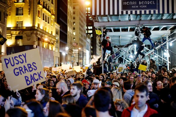 Protesters reach Trump Tower as they march against Republican president-elect president Donald Trump in the neighborhood of M