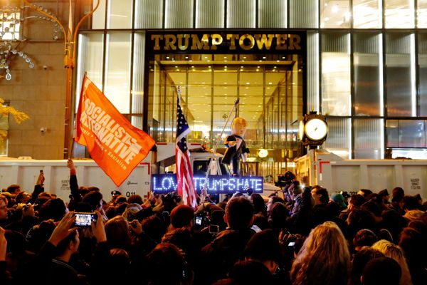 Protesters reach Trump Tower as they march against Republican president-elect Donald Trump in the neighborhood of Manhattan i