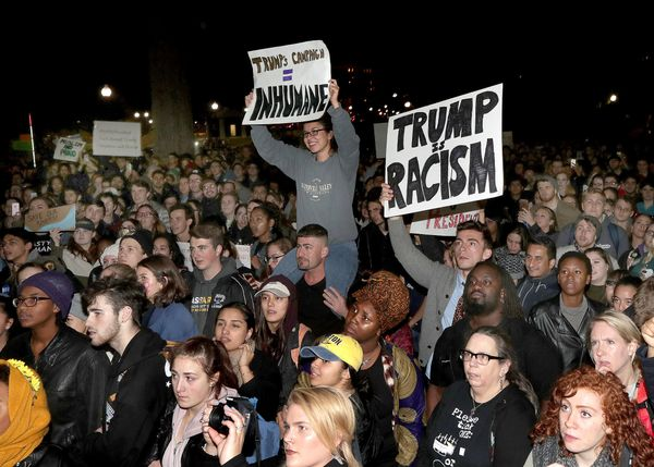 Demonstrators gather to rally against Donald Trump as president-elect at the Parkman Bandstand in Boston Common in Boston on