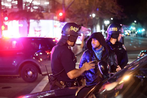 Police detain a protester marching against President-elect Donald Trump in Oakland, California, U.S., November 9, 2016. REUTE