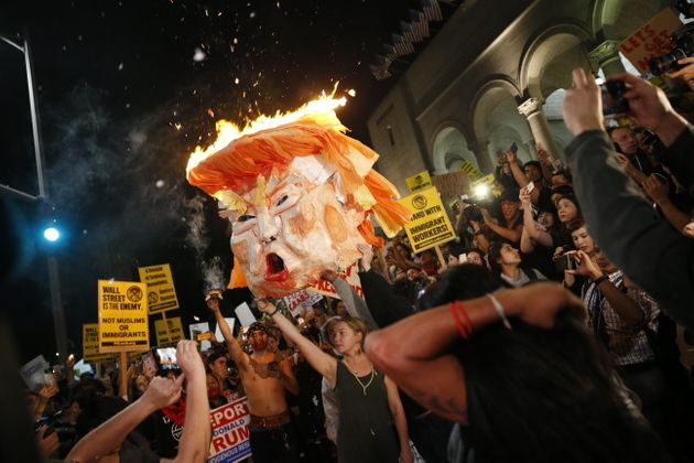 Protesters burn an effigy of Donald Trump outside Los Angeles City