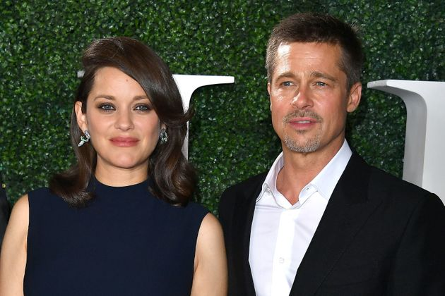Brad Pitt walked the red carpet with co-star Marion
