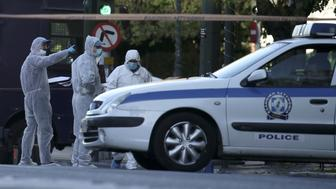 Forensics experts search for evidence outside the French embassy, where unidentified attackers threw an explosive device causing a small blast, in Athens, Greece, November 10, 2016. REUTERS/Alkis Konstantinidis
