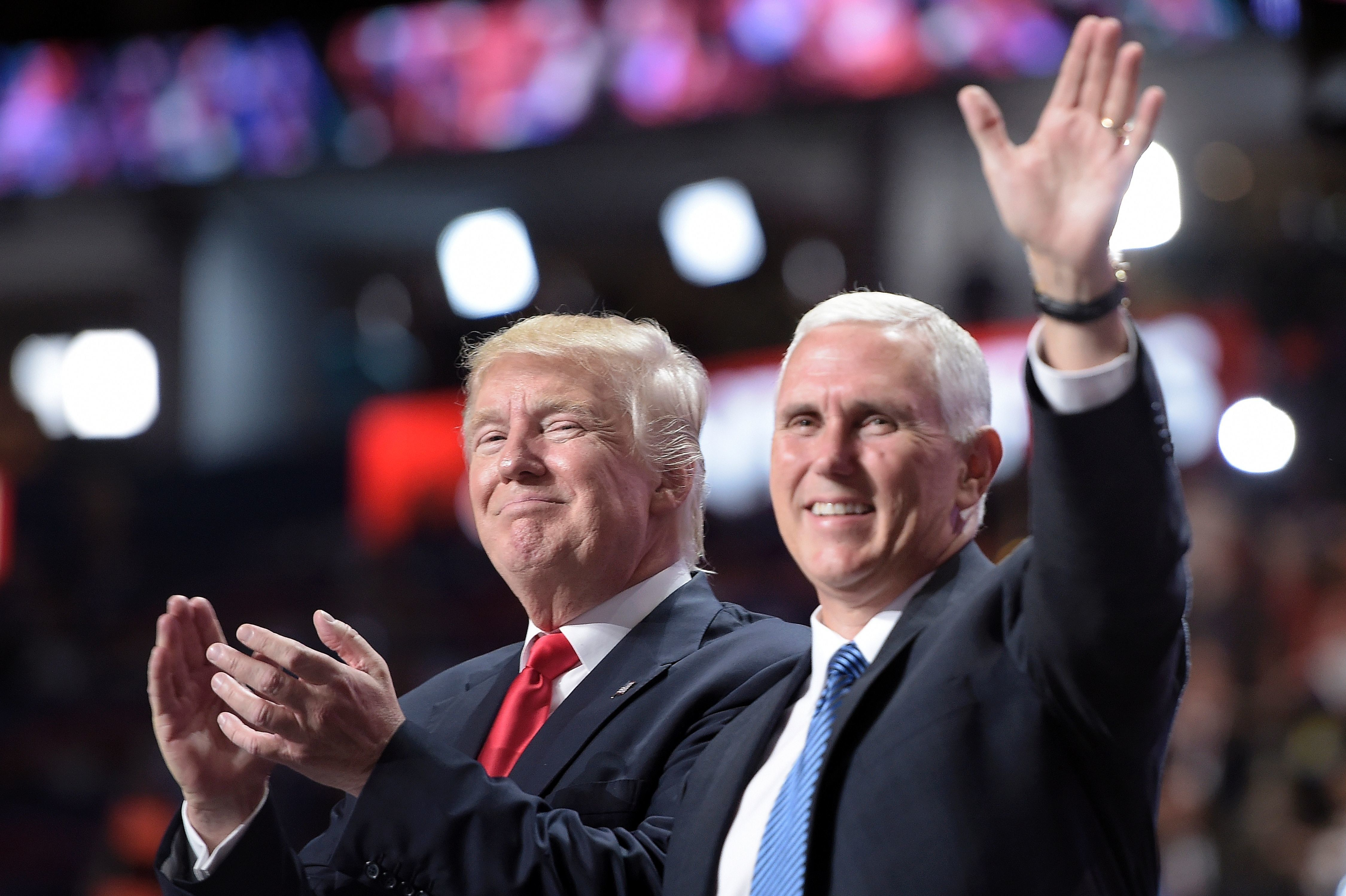 Republican Presidential candidate Donald Trump stands with vice presidential candidate Mike Pence after delivering his acceptance speech during the 2016 Republican National Convention July 21, 2016 in Cleveland, Ohio. / AFP / Brendan Smialowski        (Photo credit should read BRENDAN SMIALOWSKI/AFP/Getty Images)