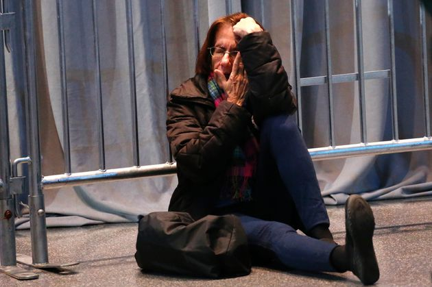 A Hillary Clinton supporter breaks down in tears at the end of election night at the Jacob K. Javits...